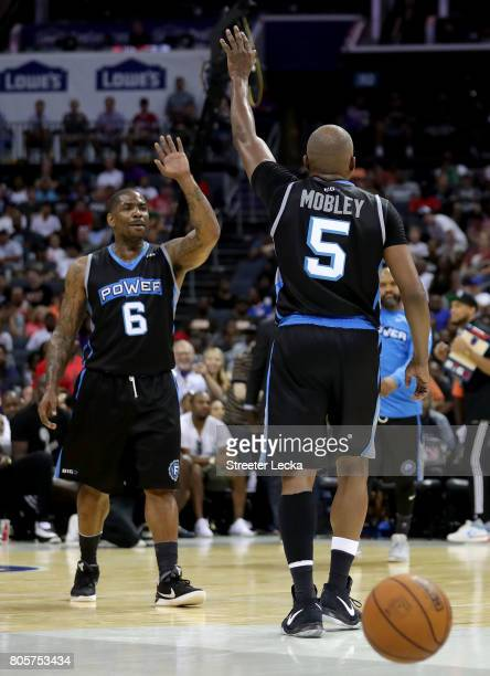 Cuttino Mobley looks for a high five from teammate Paul McPherson of Power during week two of the BIG3 three on three basketball league at Spectrum...