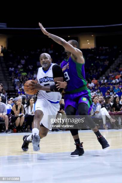 Cuttino Mobley of Power dribbles the ball while being guarded by Rashard Lewis of the 3 Headed Monsters during week three of the BIG3 three on three...