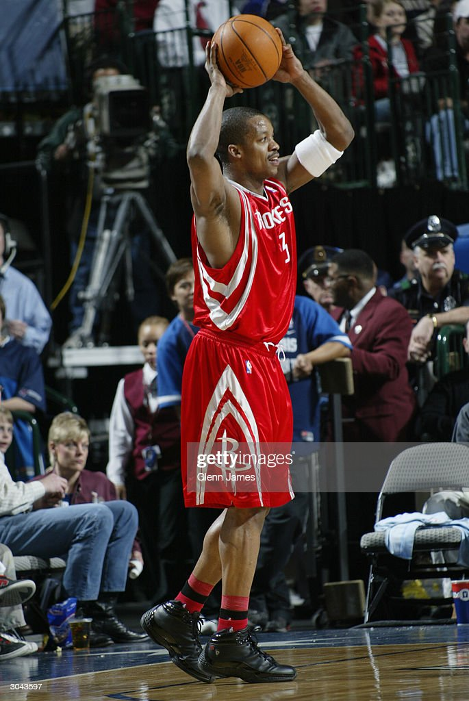Cuttino Mobley #5 of the Houston Rockets looks to pass during the game against the Dallas Mavericks at the American Airlines Arena on February 21, 2004 in Dallas, Texas. The Mavericks won 97-88.