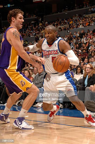Cuttino Mobley of the Los Angeles Clippers drives to the hoop against Luke Walton of the Los Angeles Clippers on April 4 2007 at Staples Center in...