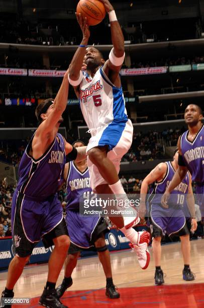 Cuttino Mobley of the Los Angeles Clippers goes strong to the hoop against Brad Miller of the Sacramento Kings on October 14 2005 at the...
