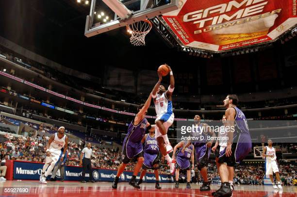 Cuttino Mobley of the Los Angeles Clippers goes strong to the hoop against Brad Miller and Peja Stojakovic of the Sacramento Kings on October 14 2005...