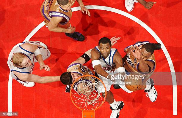 Cuttino Mobley of the Los Angeles Clippers goes strong to the hoop against Kenny Thomas and Brad Miller of the Sacramento Kings on December 27 2005...