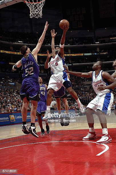Cuttino Mobley of the Los Angeles Clippers goes to the basket against Brad Miller of the Sacramento Kings during the game at Staples Center on April...
