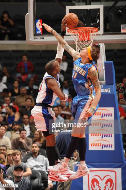 Cuttino Mobley of the Los Angeles Clippers goes up for a dunk against Chris Andersen of the Denver Nuggets at Staples Center on October 31 2008 in...