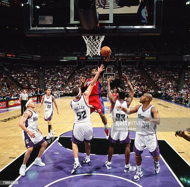 Cuttino Mobley of the Los Angeles Clippers goes up for a shot against Brad Miller Ron Artest and Corliss Williamson of the Sacramento Kings during a...