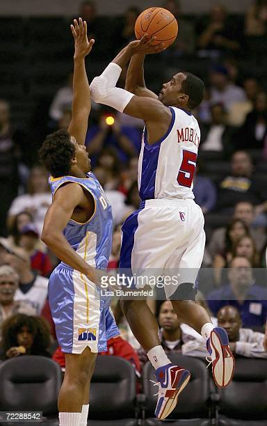 Cuttino Mobley of the Los Angeles Clippers puts a shot up against Andre Miller of the Denver Nuggets on October 27 2006 at Staples Center in Los...
