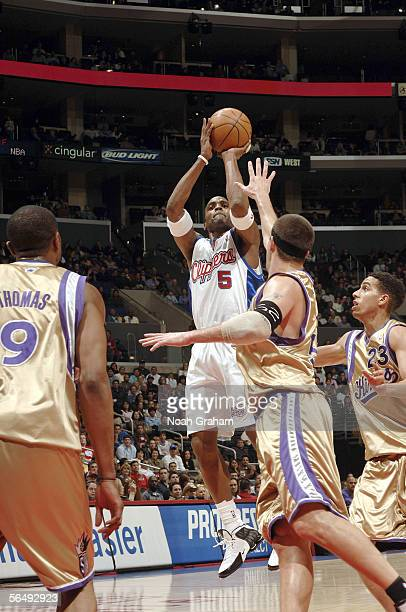 Cuttino Mobley of the Los Angeles Clippers puts up a shot against Brad Miller and Kevin Martin of the Sacramento Kings on December 27 2005 at Staples...