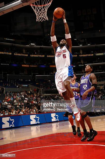 Cuttino Mobley of the Los Angeles Clippers scores on a dunk against Bonzi Wells and Brad Miller of the Sacramento Kings on October 14 2005 at the...