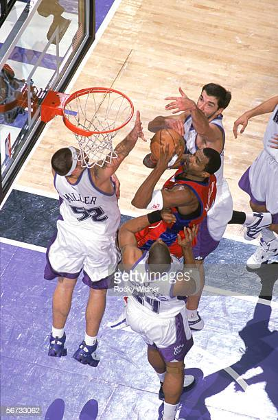 Cuttino Mobley of the Los Angeles Clippers shoots against Brad Miller and Corliss Williamson of the Sacramento Kings during the game at the ARCO...