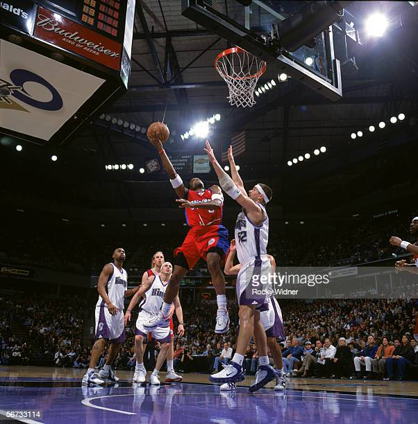 Cuttino Mobley of the Los Angeles Clippers shoots against Brad Miller of the Sacramento Kings during the game at the ARCO Arena in Sacramento...