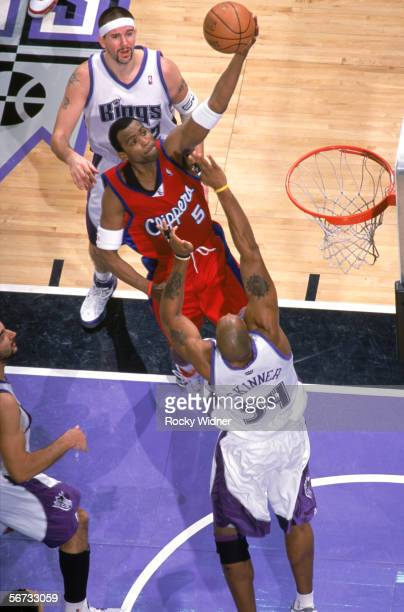 Cuttino Mobley of the Los Angeles Clippers shoots against Brian Skinner and Brad Miller of the Sacramento Kings during the game at the ARCO Arena in...