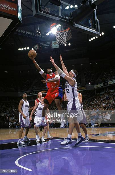 Cuttino Mobley of the Los Angeles Clippers shoots over Brad Miller of the Sacramento Kings during the game at the ARCO Arena in Sacramento California...