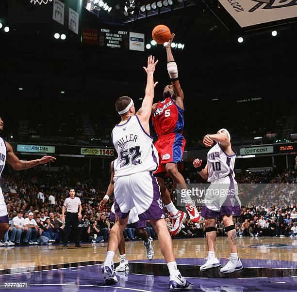 Cuttino Mobley of the Los Angeles Clippers shoots over Brad Miller of the Sacramento Kings during a game at Arco Arena on November 28 2006 in...
