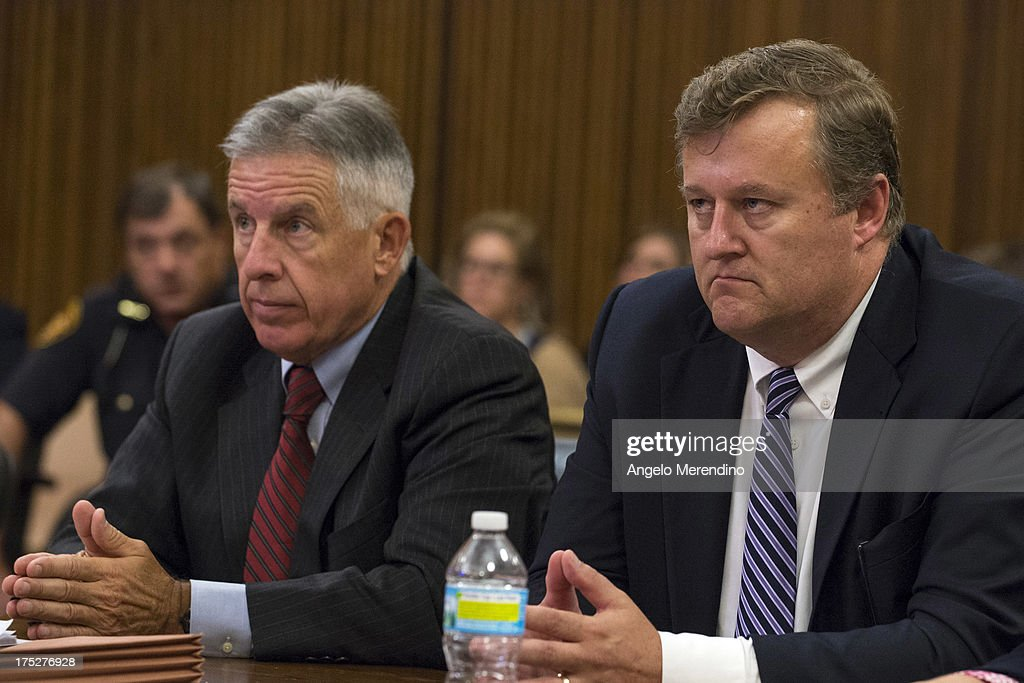 Cuyahoga County Prosecutor Tim McGinty (L) and Assistant Prosecutor Blaise Thomas listen as Judge Michael Russo addresses the courtroom during the sentencing of Ariel Castro at the Cleveland Municipal Courthouse on August 1, 2013 in Cleveland, Ohio. Castro was found guilty of abducting three women from 2002 to 2004. The women escaped from Castro's home this past May.