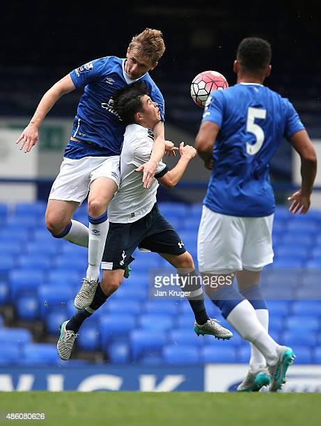 Cy Goddard of Spurs battles with Ryan Ledson of Everton during the Premier League International Cup between Everton U21 and Tottenham Hotspur U21 at...
