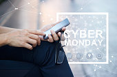 Cyber Monday, man using smartphone in hands and icon network connection on pastel outdoor background