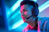 Young Asian Handsome Pro Gamer Playing in Online Video Game