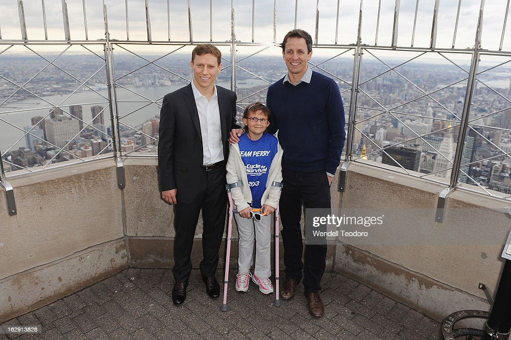 Cycle for Survival Co-Founder David Linn and Perry Zimmerman and Seth Meyers attends the lights The Empire State Building on March 1, 2013 in New York City.
