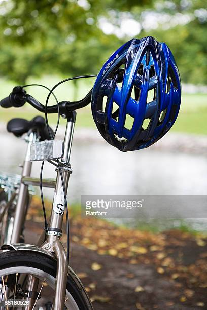 A cycle helmet hanging on the handlebars Sweden.