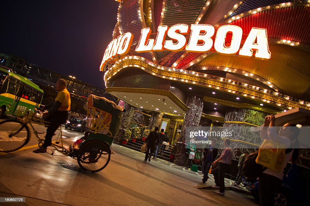 A cycle rickshaw waits for customers in front of the Casino Lisboa, operated by SJM Holdings Ltd., in Macau, China, on Wednesday, Feb. 6, 2013. Casino industry revenue in the gambling hub climbed 14 percent to a record 304 billion patacas ($38 billion) last year. Photographer: Lam Yik Fei/Bloomberg via Getty Images