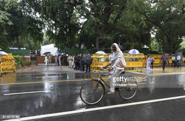 A cycle ride during the raining weather on July 14 2017 in New Delhi India