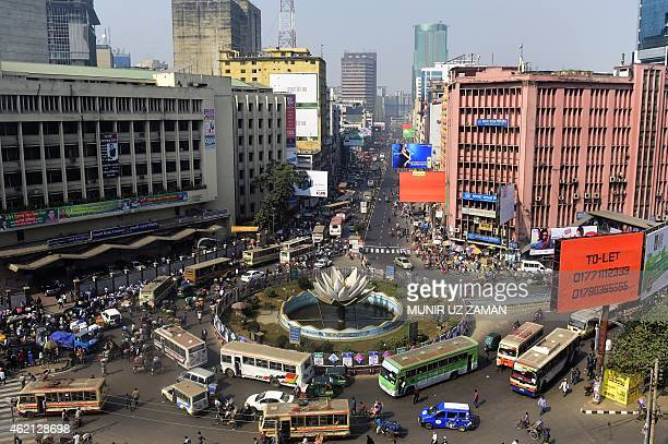 Cyclerickshaws and buses ply a street amid traffic during a nationwide strike called by the Bangladesh Nationalist Party led alliance in Dhaka on...