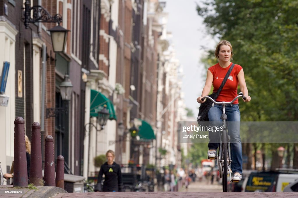 Cycling along Prisengracht. : Stock Photo