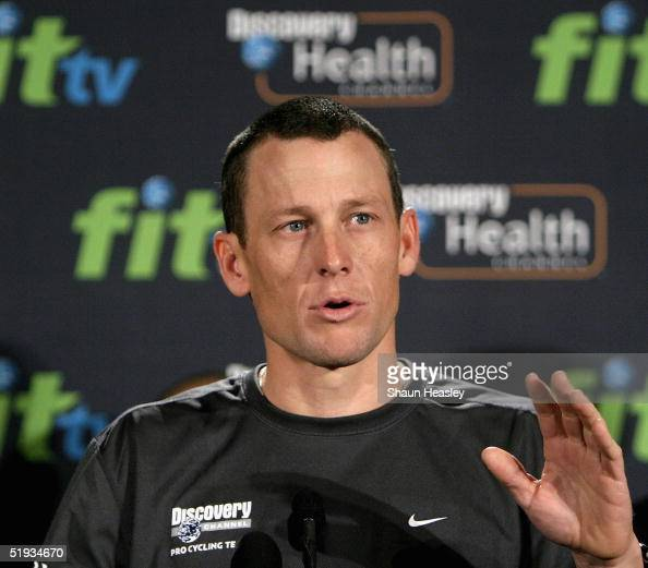 Cycling champion and six time Tour de France winner Lance Armstrong gestures during a press conference at the Cannon House Office Building on Capitol...