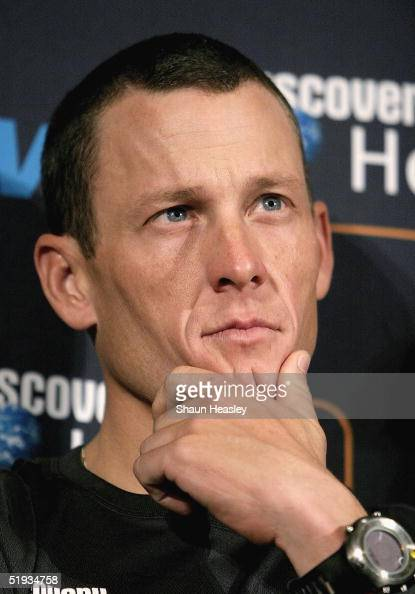 Cycling champion and six time Tour de France winner Lance Armstrong looks on during a press conference at the Cannon House Office Building on Capitol...