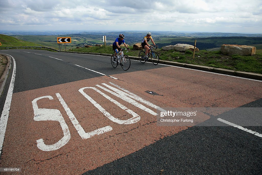 Cycling enthusiasts make their way up the Holme Moss incline, one of the highest points on route 2, as Yorkshire prepares to host the Tour de France Grand Depart, on June 24, 2014 in Holmfirth, United Kingdom. The people of Yorkshire are preparing to give the riders of the 2014 Tour de France a grand welcome as the route of stages one and two are decorated with bunting, bikes and yellow jerseys The Grand Depart of the 2014 Tour De France is taking place in Leeds with the first two stages taking place across Yorkshire on 6th and 7th of July.