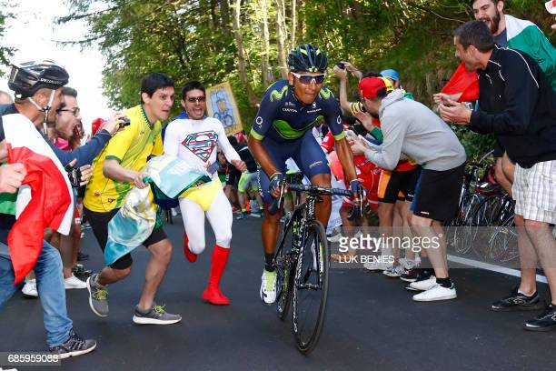Cycling fans cheer Colombia's Nairo Quintana of Movistar climbing during the 14th stage of the 100th Giro d'Italia Tour of Italy cycling race from...
