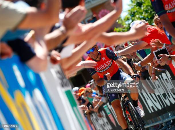 Cycling fans cheer Italy's rider of team Bahrain Merida Vincenzo Nibali as he arrives to take the start of the 15th stage of the 100th Giro d'Italia...