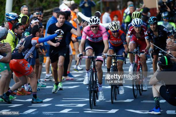 Cycling fans cheer Netherlands' Tom Dumoulin of team Sunweb riding ahead Italy's rider of team Bahrain Merida Vincenzo Nibali and Russia's Ilnur...