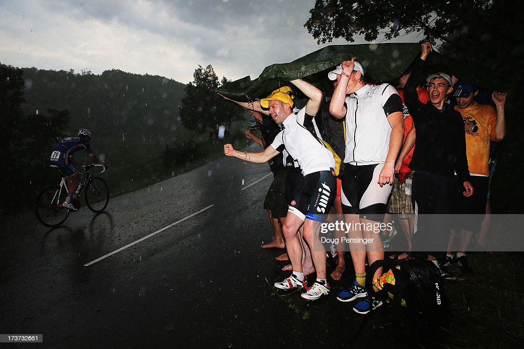Cycling fans encourage the riders in the poor weather conditions during stage seventeen of the 2013 Tour de France, a 32KM Individual Time Trial from Embrun to Chorges, on July 17, 2013 in Chorges, France.