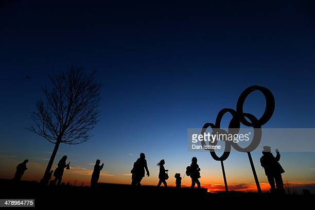 Cycling fans walk past the Olympic Rings at sunset inside the Olympic Park before attending Revolution 5 at the Velodrome in the Lee Valley Velopark...