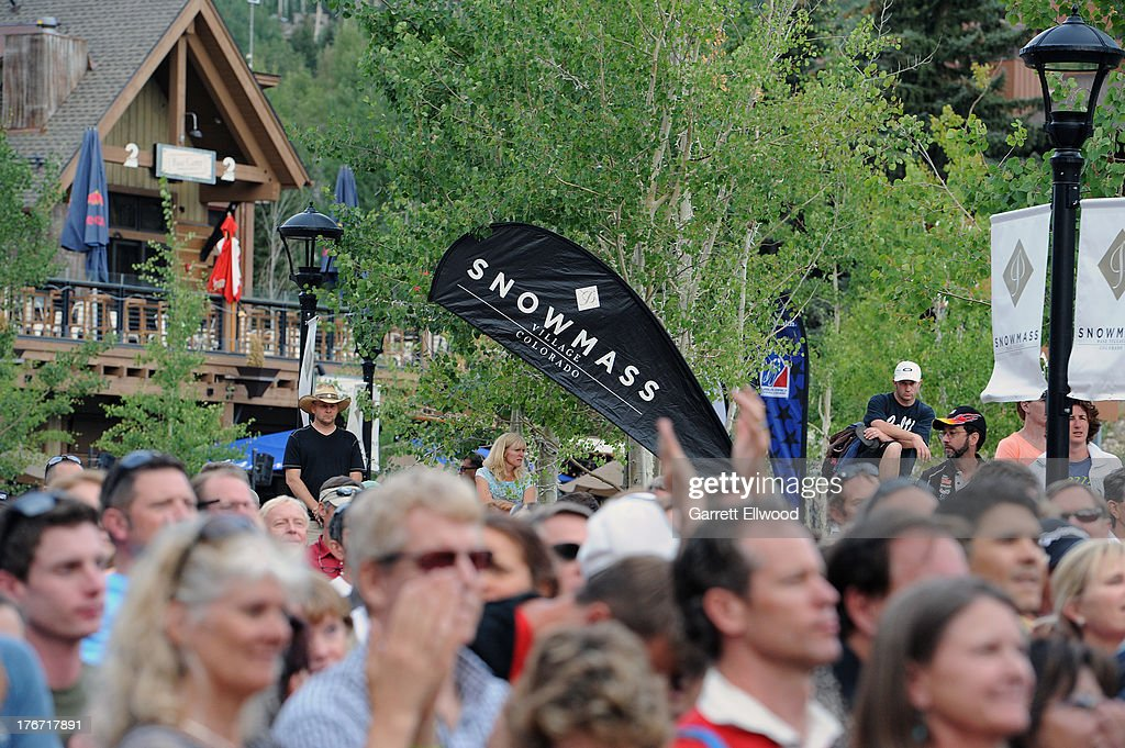 Cycling fans watch the team presentation prior to the start of the USA Pro Challenge on August 17 2013 in Snowmass Village Colorado