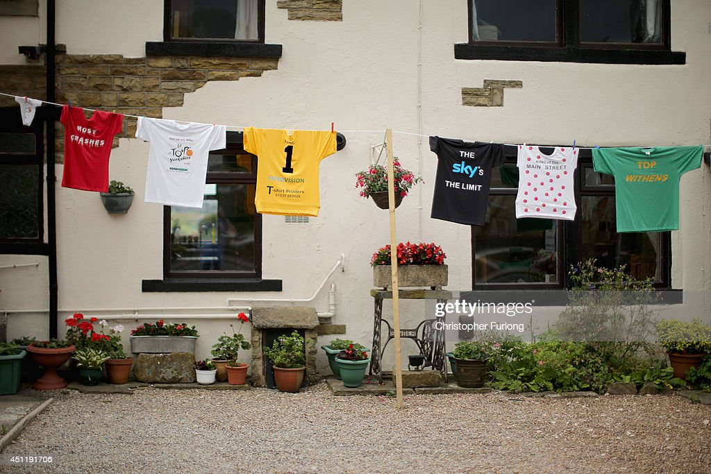 Cycling jerseys hang on the washing line of a cottage on route two as Yorkshire prepares to host the Tour de France Grand Depart, on June 24, 2014 in Haworth, United Kingdom. The people of Yorkshire are preparing to give the riders of the 2014 Tour de France a grand welcome as the route of stages one and two are decorated with bunting, bikes and yellow jerseys The Grand Depart of the 2014 Tour De France is taking place in Leeds with the first two stages taking place across Yorkshire on 6th and 7th of July.