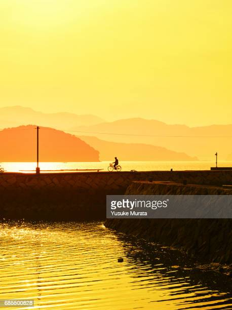Cycling on pier at sunset