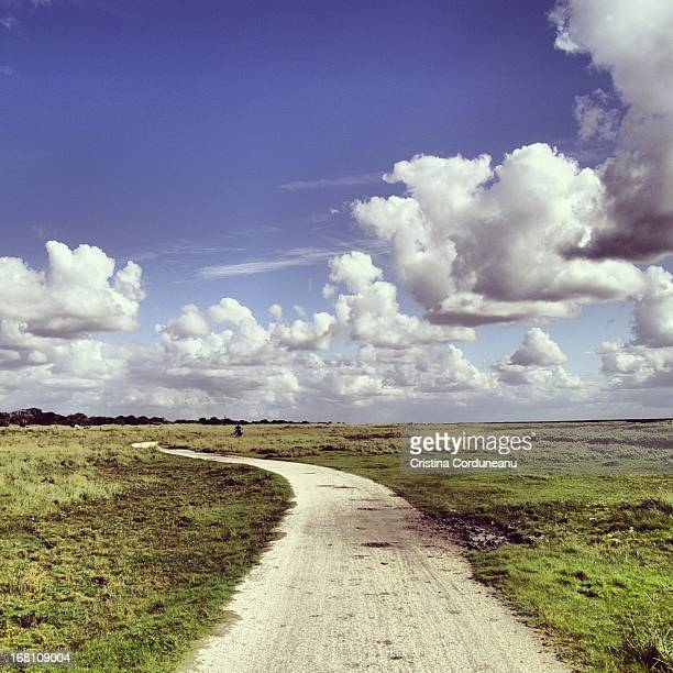 Cycling path on Schiermonnikoog island, day with c