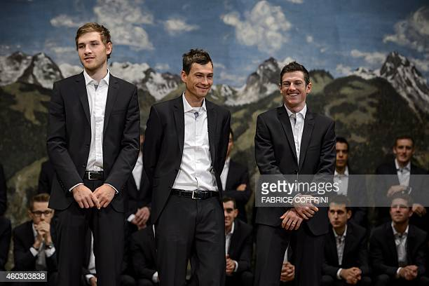 Cycling racers Matthias Brandle and Stefan Denifl both from Austria pose with leader Mathias Frank of Switzerland during the presentation of the 2015...