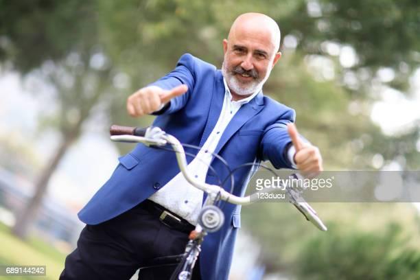 Cycling Senior Businessman