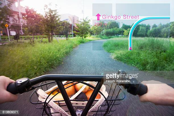 Cycling with navigator seen through smart glasses.