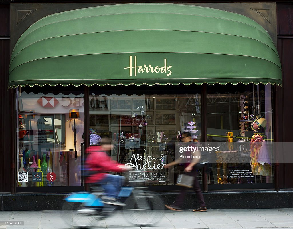 A cyclist and a pedestrian pass outside Harrods luxury department store in London, U.K., on Monday, June 24, 2013. Harrods, which has more than 1 million square feet (90,000 square meters) of selling space, isn't concerned about the outlook for spending on luxury goods, Harrods Managing Director Michael Ward said. Photographer: Jason Alden/Bloomberg via Getty Images