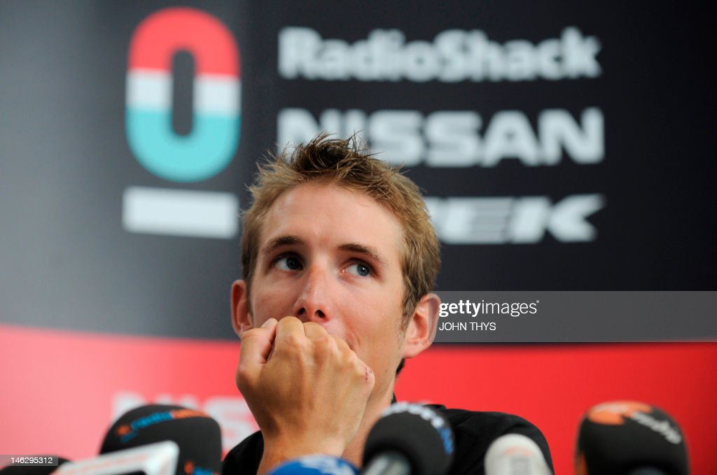 Cyclist Andy Schleck of Luxembourg listens to questions during a press conference in Strassen on June 13, 2012. Yellow jersey contender Schleck has pulled out of this year's Tour de France due to injuries suffered in last week's Criterium du Dauphine race.