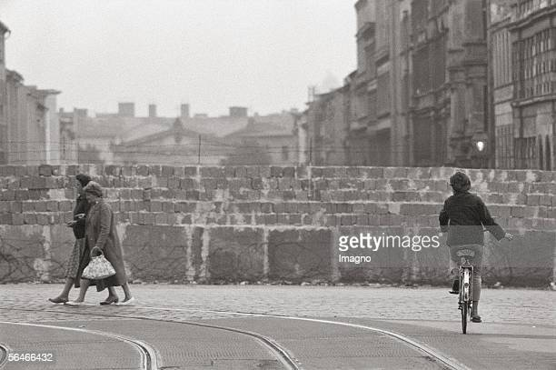 Cyclist at the Berlin Wall Photography Germany 1961/62 [Radfahrerin an der Berliner Mauer Photographie Deutschland 1961/62]