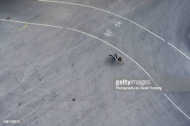 Cyclist biking beside bike path