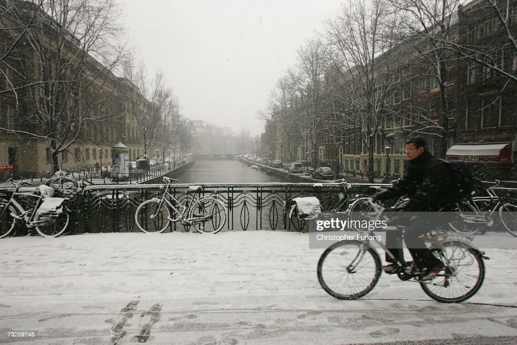 A cyclist braves the snow on February 8, 2007, in Amsterdam, Netherlands. The Dutch transport system has suffered delays across the country, with an expected 5-10 centimetres due to fall, according to The Dutch Meteorological Institute.