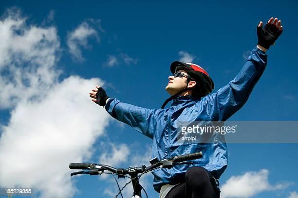 cyclist celebrating his triumph