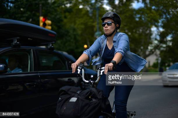 Cyclist commutes on the Parkway as the Parkway100 centennial celebration kicks off at the Benjamin Franklin Parkway in Philadelphia PA on September 8...